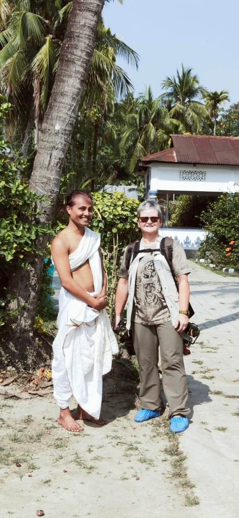 Celebrating the life of a monk in Uttar Kamalabari Satra with a foreign tourist from France