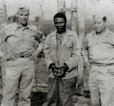 Captured in March 1945, Pvt. Herman Perry is held at the Intermediate Section Stockade near Chabua.