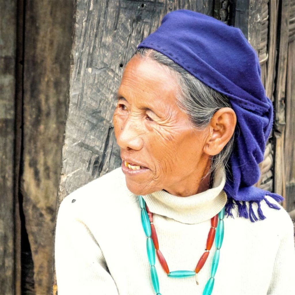 An old lady in Kohima wearing traditional ornaments