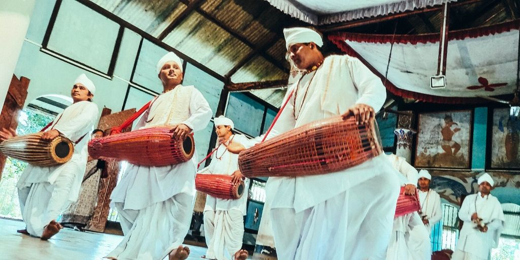 Monks performing 'gayan bayan' dance at the Uttar Kamalabari Sattra in Majuli