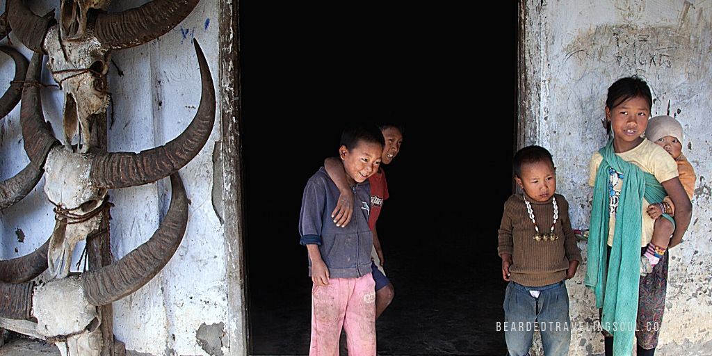 Young ones outside a traditional house in Mon ,Nagaland