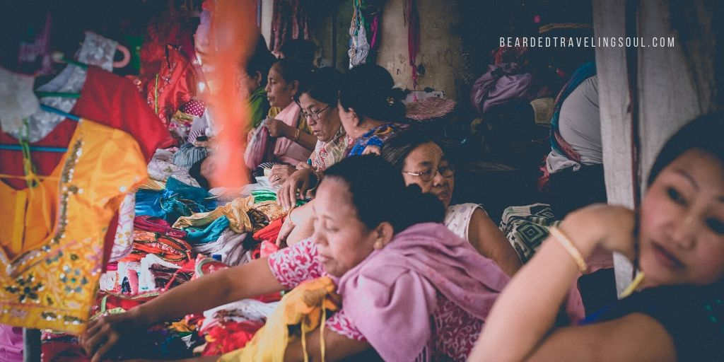 Ladies at the 'IMA' market in Imphal, Manipur - Photography by  puncturesandpanniers