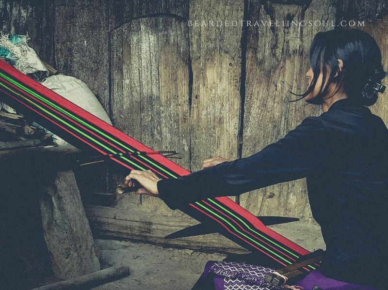 A Naga lady weaving a traditional Angamai woolen Sarong in Viswema Village
